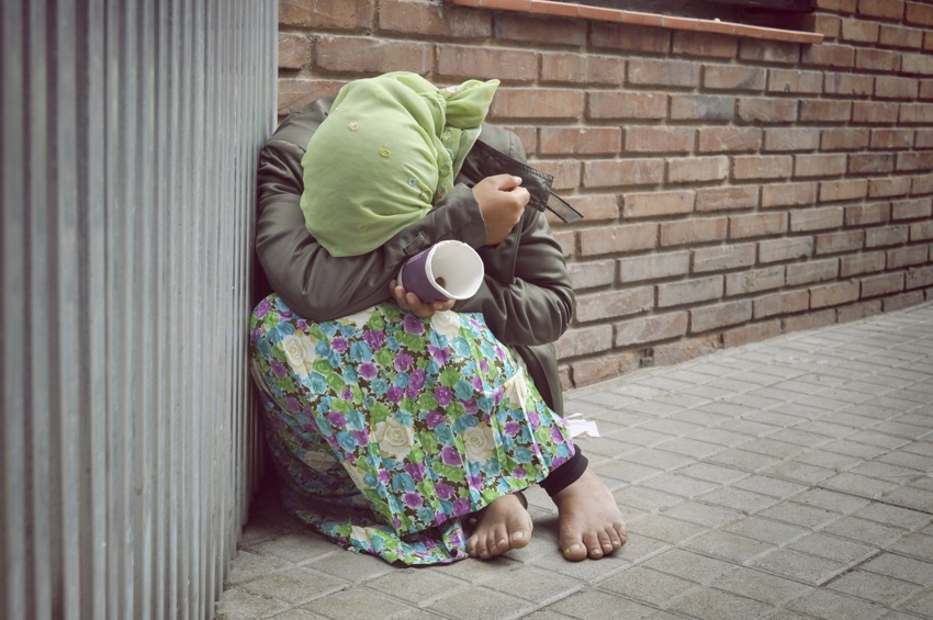 homeless girl is begging for money